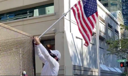 'We All Should Be Patriotic': Veteran Hangs American Flags At Portland Courthouse