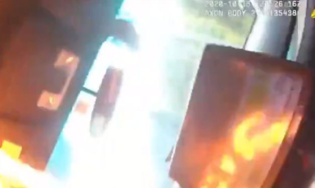 Watch: Seattle Police Car Torched with Officer Still Inside