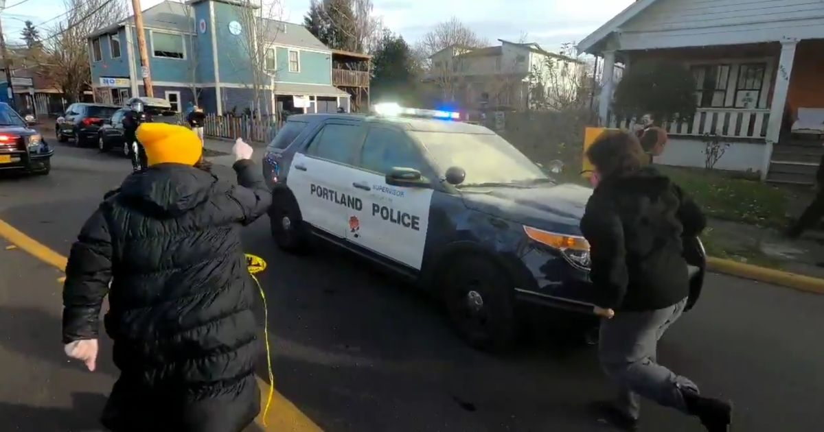 Watch: Video Shows Portland Cops Forced To Run Away from Leftist Mob Physically Attacking Them